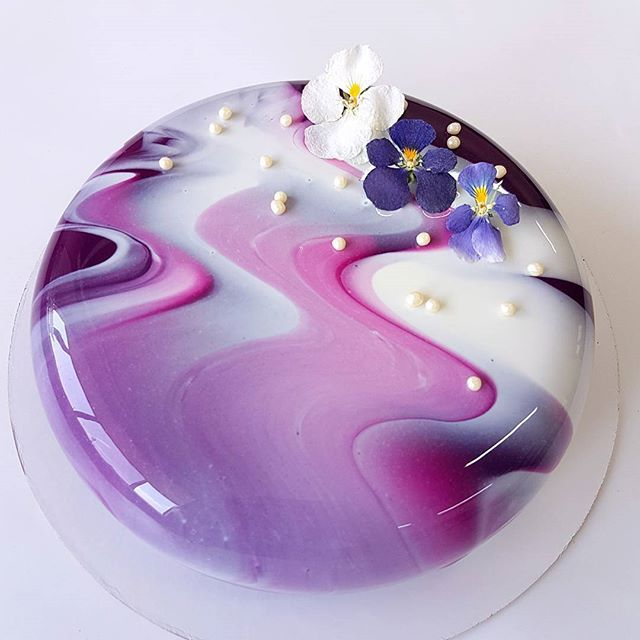 Marbled effect mirror glaze cake with edible flowers - For all your cake decorating supplies, please visit craftcompany.co.uk