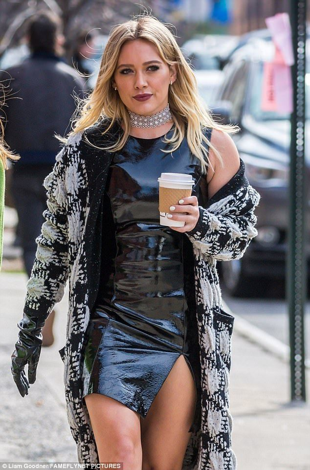 Hell for leather: The blonde beauty wore a black leather mini dress that featured a slit up her thigh
