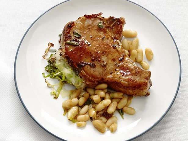 Cheese-Stuffed Pork Chops : Soak thick-cut chops in a sweet-and-salty brine for a few minutes, then stuff with provolone cheese and an escarole-garlic mixture. Serve with sage-infused cannellini beans on the side. via Food Network