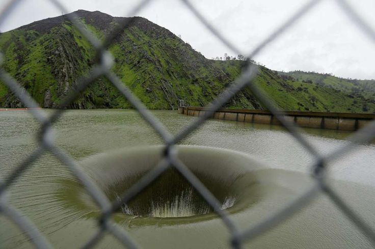 California storms:     Water flows into the iconic Glory Hole spillway at Monticello Dam on on Feb. 20, 2017, in Lake Berryessa, Calif. Water is flowing for the first  time in over a decade into the 72‐foot diameter hole due to the recent storms in California. The unique spillway operates similarly to a  bathtub drain. Heavy downpours are swelling creeks and rivers and bringing threats of flooding in California's already soggy northern and  central regions.