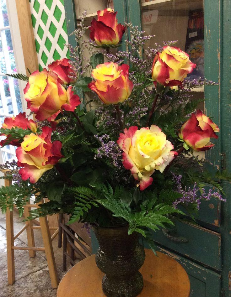 Flower arrangement, flower arrangement in a vase, dozen roses in a vase, dozen rose flower arrangement, yellow rose flower arrangement, red and yellow flower arrangement
