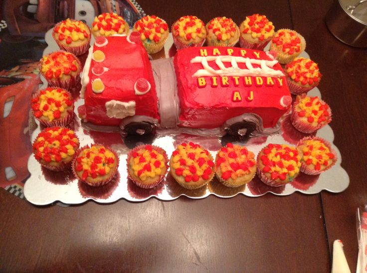 Fire engine cake with flame cup cakes