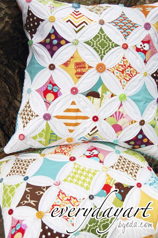 love the buttons on the cathedral window quilted pillow!