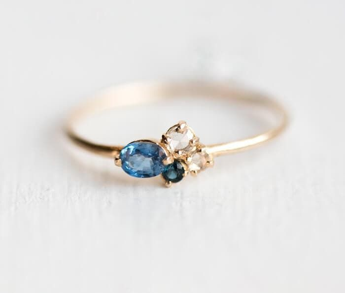 Blueberry mini cluster ring by Melanie Casey, Sapphire and Diamond asymmetrical ring in 14k yellow gold