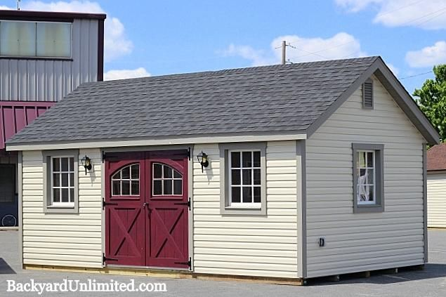 12'x20' Garden Shed with Vinyl Siding, Carriage House Doors, 9-Lite Wood Windows, Additional Window and Gable Vent http://www.backyardunlimited.com/sheds.php