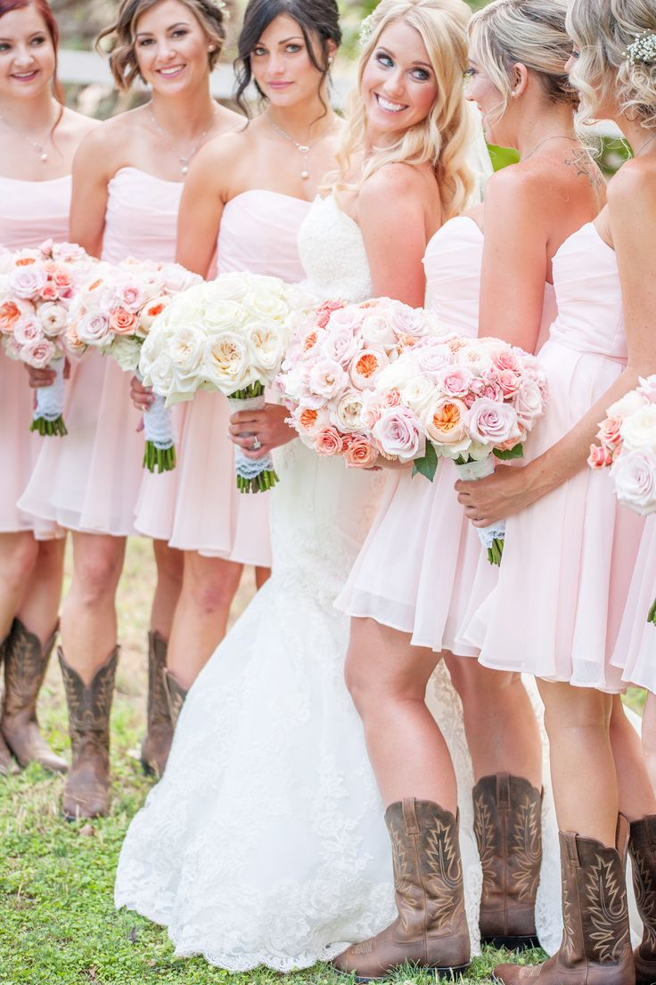 cute bridesmaids in pink dresses and cowboy boots