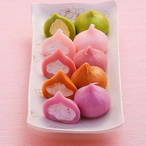 Mochi Dumplings with Cream Filling. Flavors: matcha (green tea), white peach, raspberry, coffee, purple sweet potato