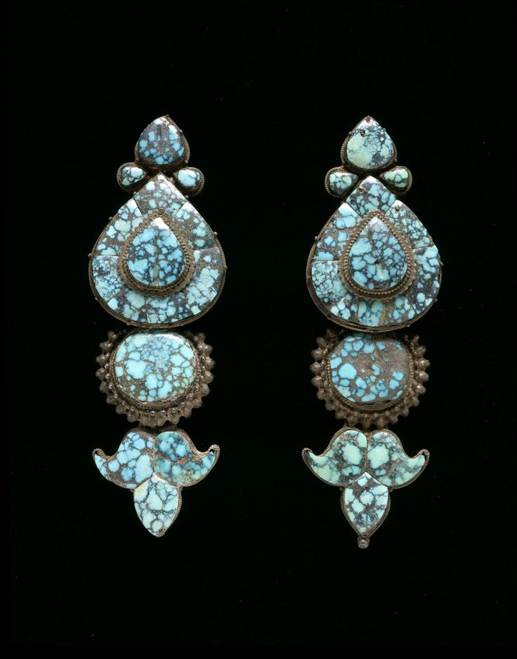 Akor (ear ornament), one of pair, silver set with turquoise, teardrop-shaped with stylised lotus bud tip, favoured style worn by Lhasa women attached to headdress: Tibet, Lhasa, 19th century AD