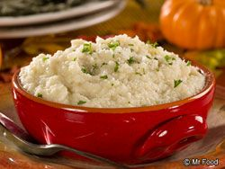 Parmesan Mashed Cauliflower | These fake-out mashed potatoes will fool all your family and friends. Not only are they cheesy and delicious, but they're good for you, too!