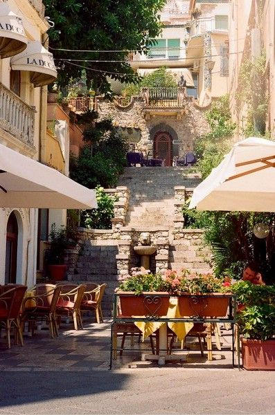 I wish to have a cup of coffee with newspaper on the other hand here.    Stairway, Taormina, Sicily, Italy