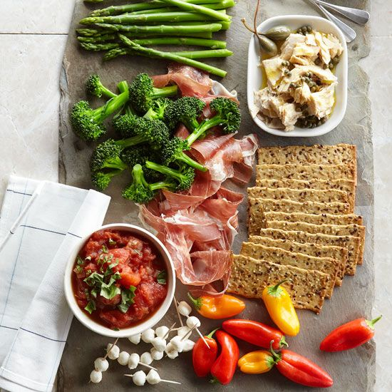 One of the quickest ways to pull together a party appetizer is to present a charcuterie platter. Ours is full of fresh veggies, meats, and cheeses, but the possibilities are endless! http://www.bhg.com/recipes/party/appetizers/new-years-party-appetizer-recipes/?socsrc=bhgpin122714antipastoplatterwithtomatochutney&page=2