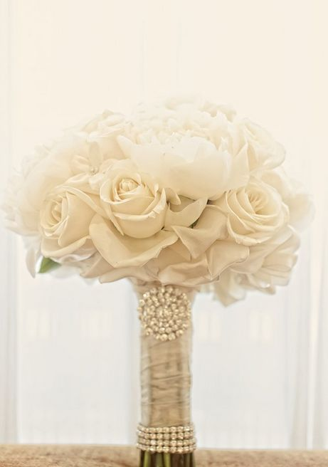 All white #wedding bouquet ideas. To see more: www.modwedding.com