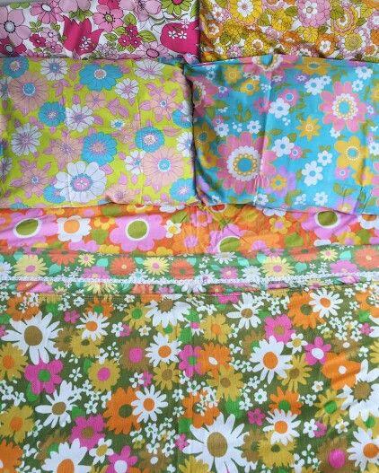 Mismatched flower power bedding makes me smile!