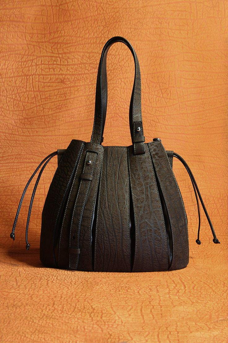 A tangerine backdrop - Via Veneta untamed. the genuine buffalo FERN bag