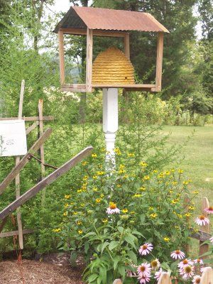 Cute idea for bird house. I could make this myself from scrap lumber, an old basket, and an old spindle from the ReStore.