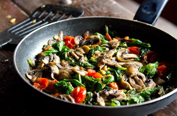 Spinach & Mushroom Fry Up Recipe with butter, button mushrooms, virgin olive oil, yellow onion, cherry tomatoes, lemon rind, garlic cloves, spinach leaves, sea salt, ground black pepper, nutmeg, lemon juice