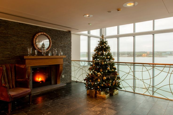 Christmas tree beside the fireplace, at the Cliff House Hotel