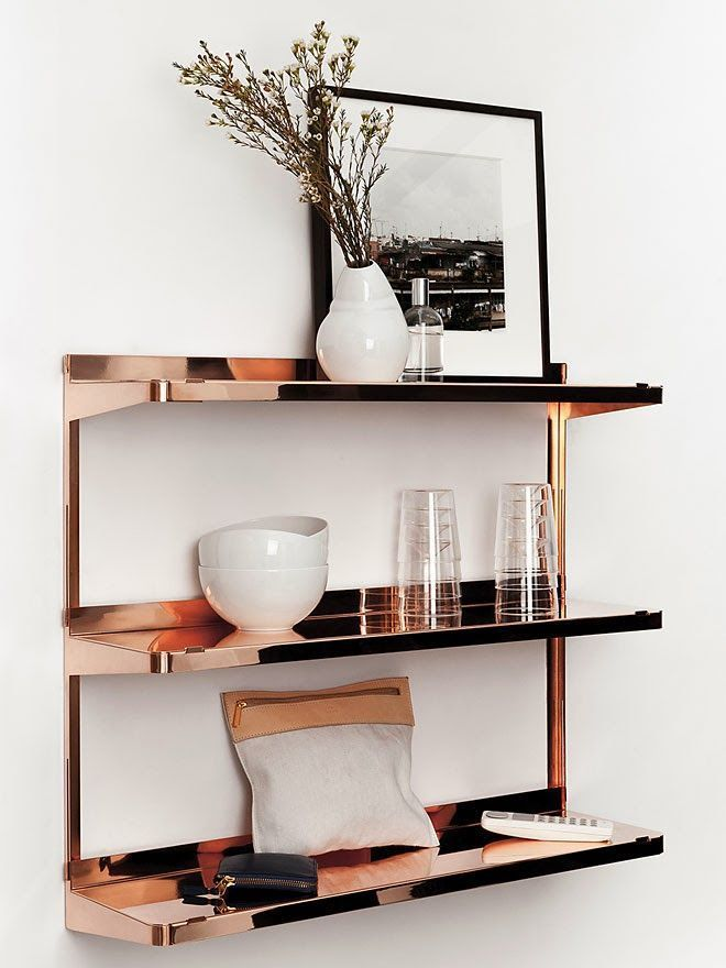 Copper is definitely on the rise and this rosy hued metal is so perfect in a kitchen or dining room.  Love how these simple custom shelves shine and reflect the dishes and glass wear.