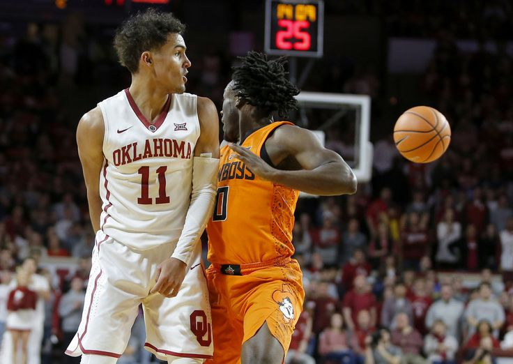 Oklahoma's Trae Young (11) passes the ball behind his back past Oklahoma State's Brandon Averette (0) during a Bedlam basketball game between the Oklahoma Sooners (OU) and the Oklahoma State Cowboys (OSU) at Lloyd Noble Center in Norman, Okla., Wednesday, Jan. 3, 2018. Photo by Bryan Terry, The Oklahoman