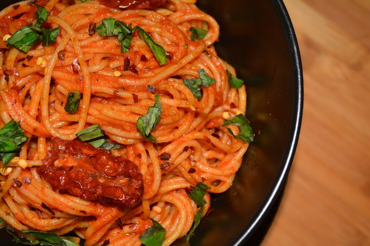 Make this quick easy and spicy Arrabbiata Pasta with the spaghetti pasta cooked in tomato sauce and flavoured with the freshness of basil leaves. This is a quick and delicious recipe. Serve with a glass of wine or fresh fruit juice for a wholesome dinner. Recipe by Pooja.    --> http://ift.tt/1rKPdM9 #Vegetarian #Recipes