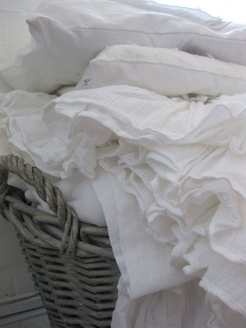 so beautiful....a basket full of crisp white linens.