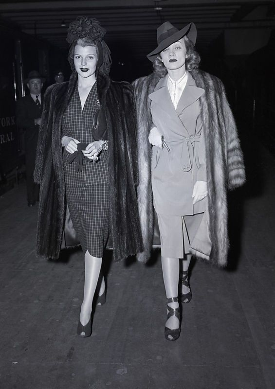 "Rita Hayworth and Marlene Dietrich. Dietrich looks like the coolest ""mean girl"" that there has ever been. -- 1940s women's fashion #fashionhistory"