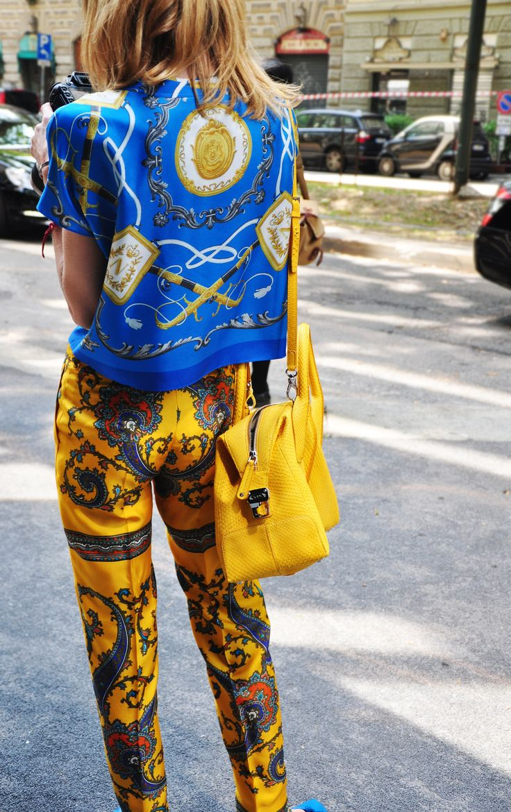 This girl is making mixed prints look oh-so simple. Now, where do I get those scarf print pants from?