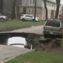 WATCH: Sinkhole swallows 3 cars in Chicago