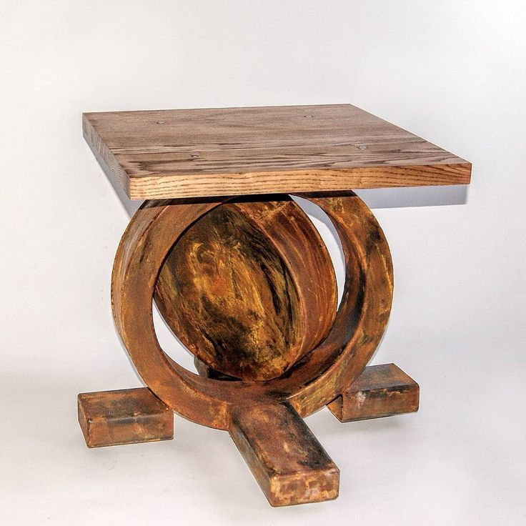 Asymmetric anchor-like acid etched steel base secured with a transparent varnish and thick (3.5 cm) oiled, ash tabletop.  Despite its unusual design this piece of furniture fits perfectly in loft and apartment spaces thanks to its natural colour.