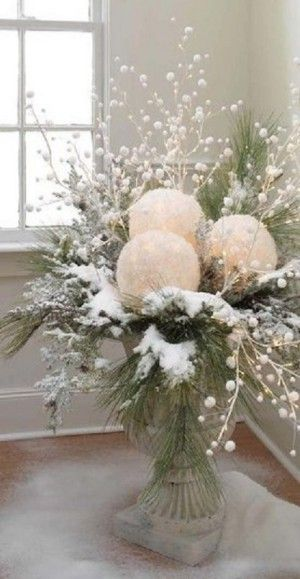 Battery operated Christmas lights inside of frosted glass globes in Christmas flower arrangement - LM