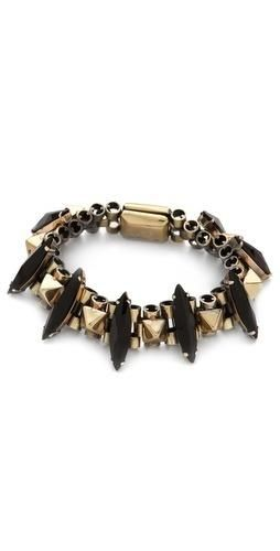 FREE SHIPPING at shopbop.com. This Iosselliani bracelet alternates black rhinestone spikes with polished pyramid studs for an orderly, yet edgy design. Magnetic clasp. Brass. Made in Italy.... More Details