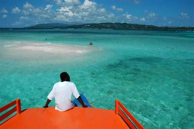 Nylon pool tobago way out from shore you can stand up for Stand up pool
