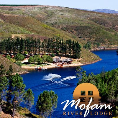 Luxurious outdoor Log Cabins at Mofam River Lodge in the Elgin Valley, Cape Province