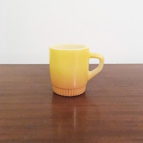 $8    Vintage 1960s Anchor Hocking Fire King Yellow and Orange Stackable Coffee Mug / Retro Tea Cup by V1NTA6EJO