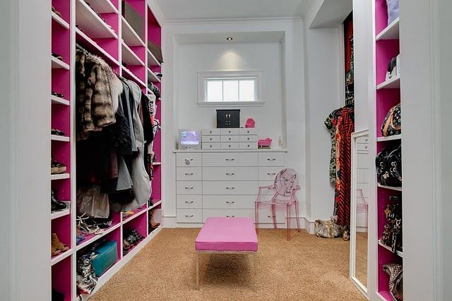white and pink closet with enough space for shoes and ...