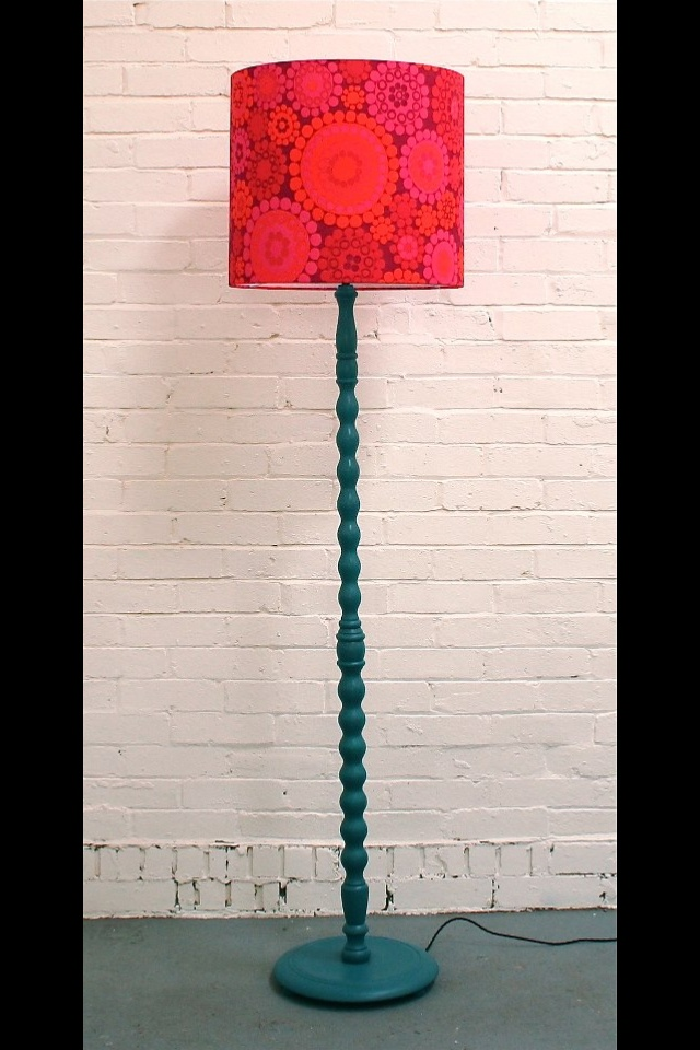 An upcycled vintage wooden standard lamp painted with