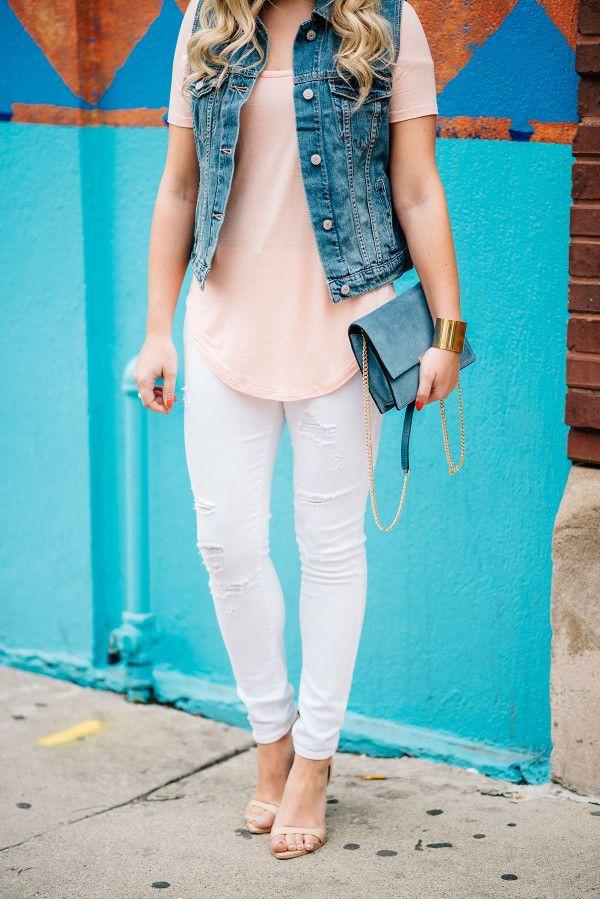 ripped white jeans outfit // denim vest, long tee shirt, cornflower blue handbag