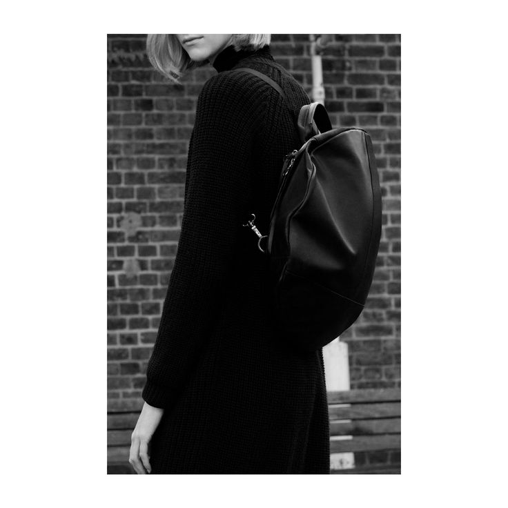Designed to be worn as a rucksack or a shoulder bag, the circular form of the Moselle Alias (seen here in soft black leather) creates a comfortable shell for when you're beetling about.