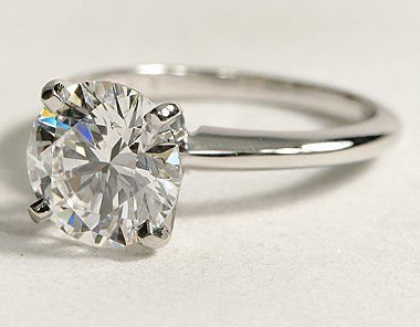 Classic 4 prong ring with 2 carat center stone. this is exactly what i want! so gorgeous