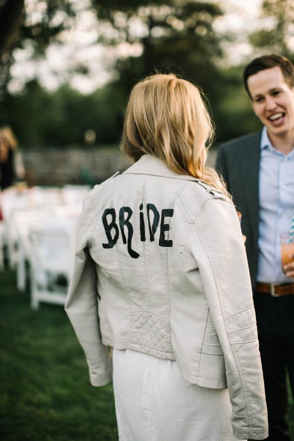 A leather jacket is a fun way to add a little edge to your bridal look for the reception while also staying warm on a chilly evening. | Image by AGPcollective