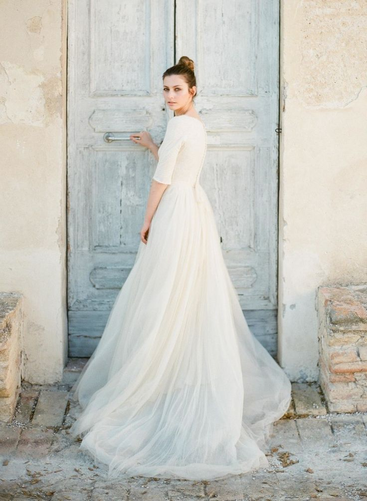 Modest 3/4 sleeve wedding gown. Photography: Greg Finck - www.gregfinck.com Wedding Dress: Cortana - www.cortana.es Read More on SMP: http://www.stylemepretty.com/2015/09/14/romantic-italian-villa-wedding-inspiration-2/