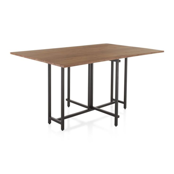 The Origami drop leaf dining table unfolds its updated look in black metal and beautifully grained acacia wood, bleached and stained light walnut.  Lift the leaves and pull out the center leg on each side to transition it in an instant from slim, compact console to dining room table.  A great staple for small spaces or multifunctioning rooms.  Seats four, with a holiday factor of up to six.