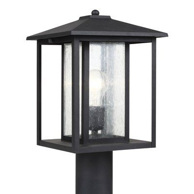 Hunnington One Light Outdoor Post Lantern with Clear Seeded Glass A bit of Shaker minimalism mixed with Arts and Crafts styling defines the transitional Hunnington Outdoor Collection. Equally at home in the city or the country, this timeless style will enhance the appearance of a home's entrance and illuminate outdoor spaces nicely. The sleek profile and muted finish options complement a wide range of residential architecture. Clear bulbs recommended for this fixture