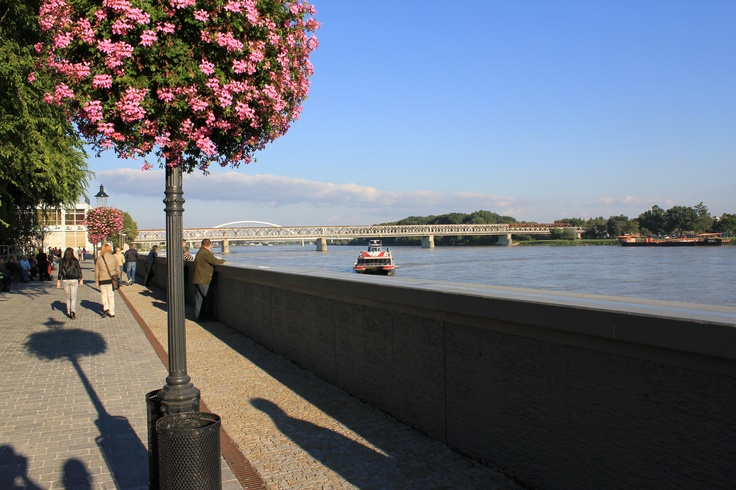 View across the Danube in Fall in Bratislava, Slovakia. I love this time of year. Everyone is out walking and enjoying the weather before the cold comes, and the restaurants and coffee houses are busy into the night.