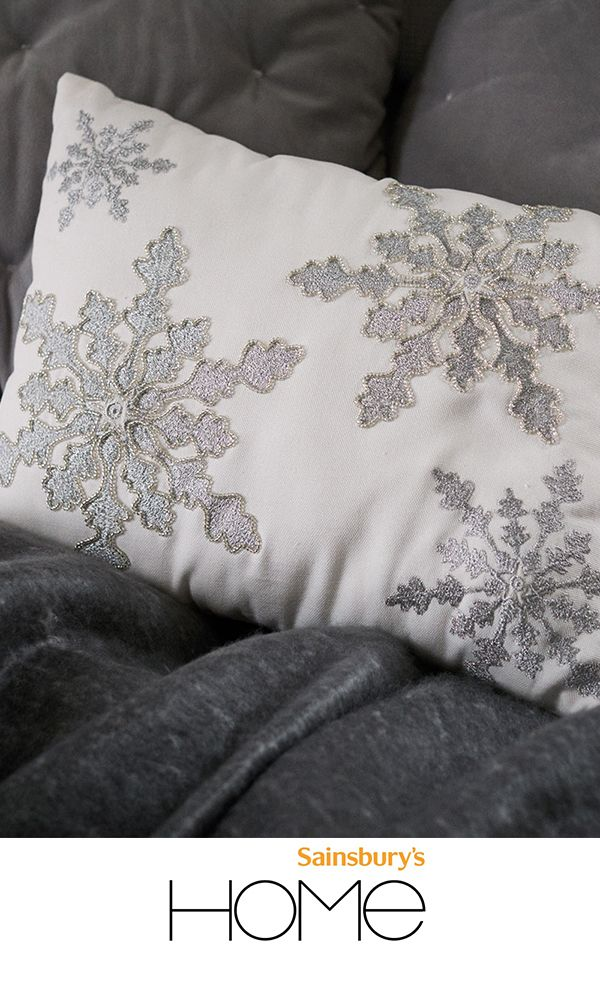 Embrace the beauty of winter with an embroidered snowflake cushion.