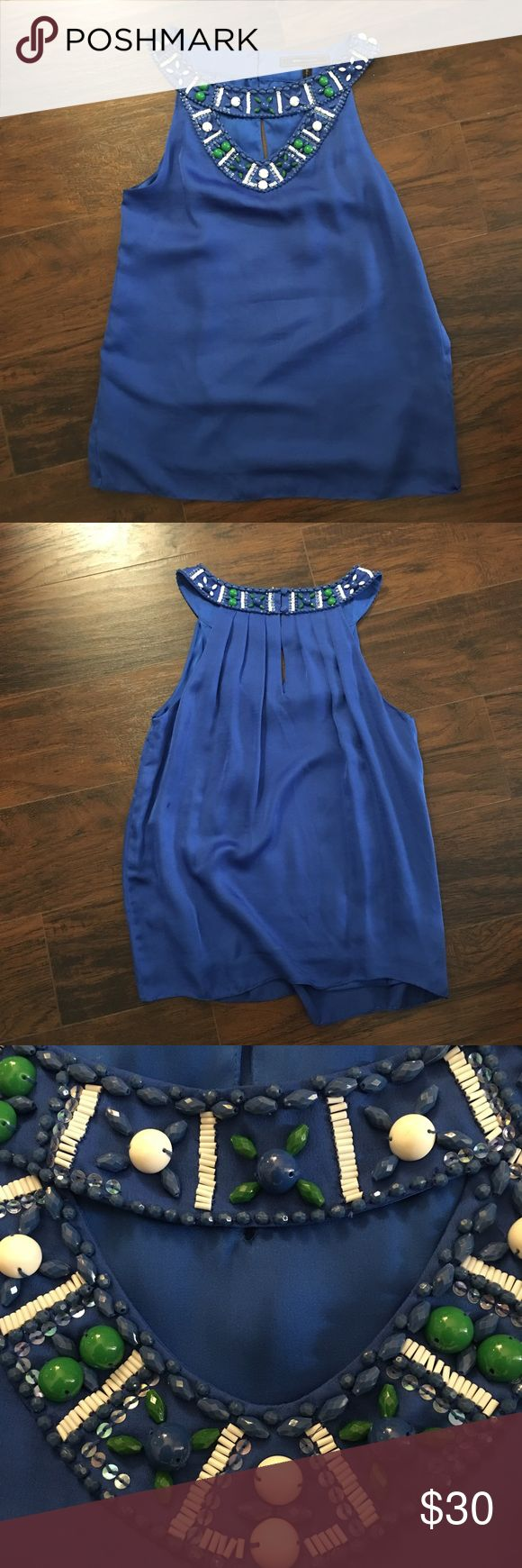 BCBGMAXAZRIA top BCBGMAXAZRIA top. This is a silky soft fabric with beaded detail around the neck. Dress the up or down. This is definitely a statement piece. BCBGMaxAzria Tops