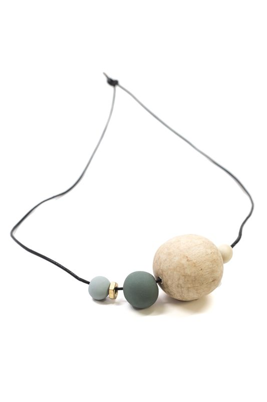 """Soft and neutral colors and a mix of shapes make this necklace a wearable piece of art. Hang it up when you aren't wearing it to keep displaying its unique beauty! Dimensions: Measures 27"""" in length."""