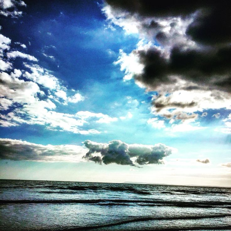 Big clouds East Wittering beach by Lizzie Reakes