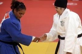 """Olympics 2012: Two women make history at judo, America's Harrison and Saudi's Shaherkani   Washington Times Communities - Today Harrison is now the first American judo athlete, male or female, to ever win an Olympic gold. Her victory was a major upset of crowd favorite Gemma Gibbons of Great Britain with a pair of yukos at 3:54 and 0:59.  Harrison said """"you know Gemma showed up. She fought with a lot of heart….She is a fierce, fierce competitor and she has a lot of heart. Today was just my…"""