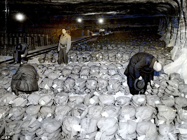 Art haul looted by Nazis goes online in bid to return masterpieces to owners. Captured: Soldiers from General Patton's Third Army stand among gold reserves stashed away in a salt mine.